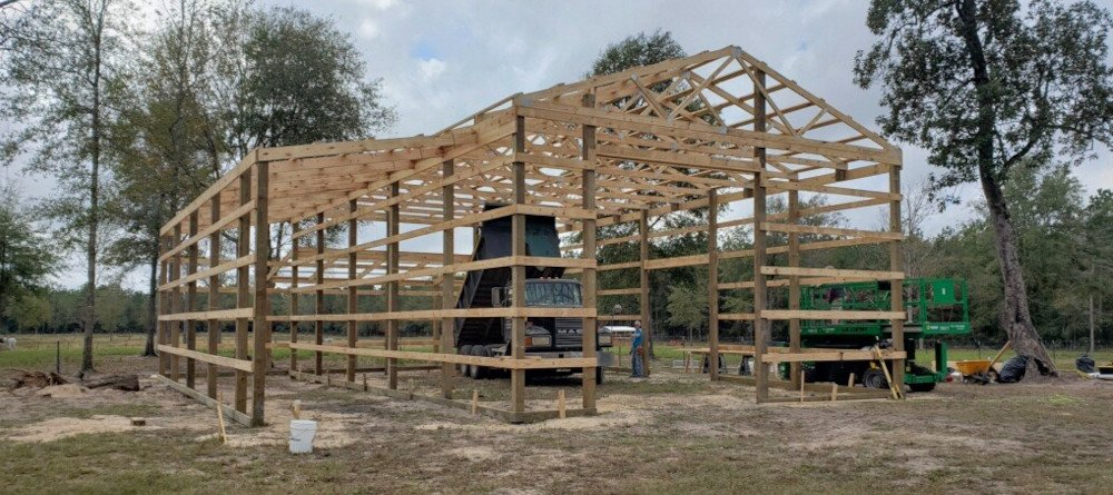 framing-lumber-and-square-timber-pilings-for-barn